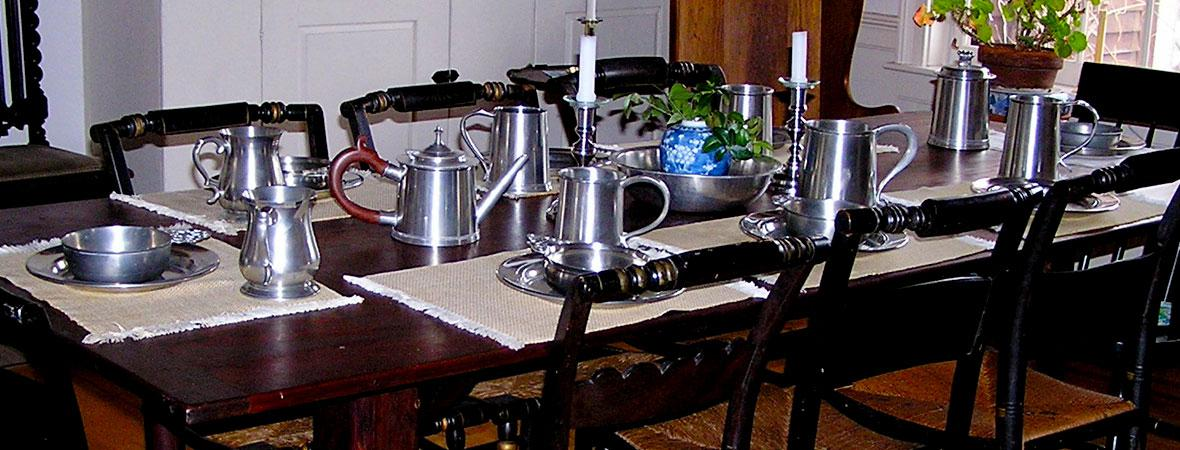 photo of table with complete pewter setting