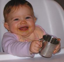 Photo of a Very Satisfied Customer with her Baby Cup
